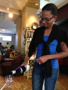 Owner of TheWine Cellars- Renee Rowe pours wine during the tasting.