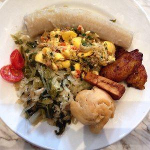 Jamaican breakfast with ackee and saltfish, fried dumpling, boiled banana, callaloo