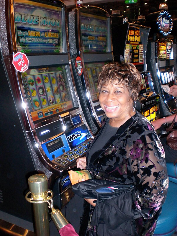 Mom trying her luck on slot machines on a cruise ship!