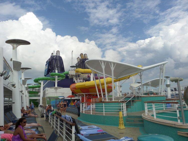 Pool deck with water slides on Norwegian Epic cruise ship.