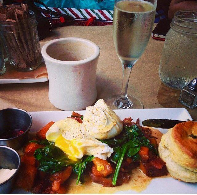 Eggs Benedict with biscuits and sweet potato hash at Sun in My Belly!