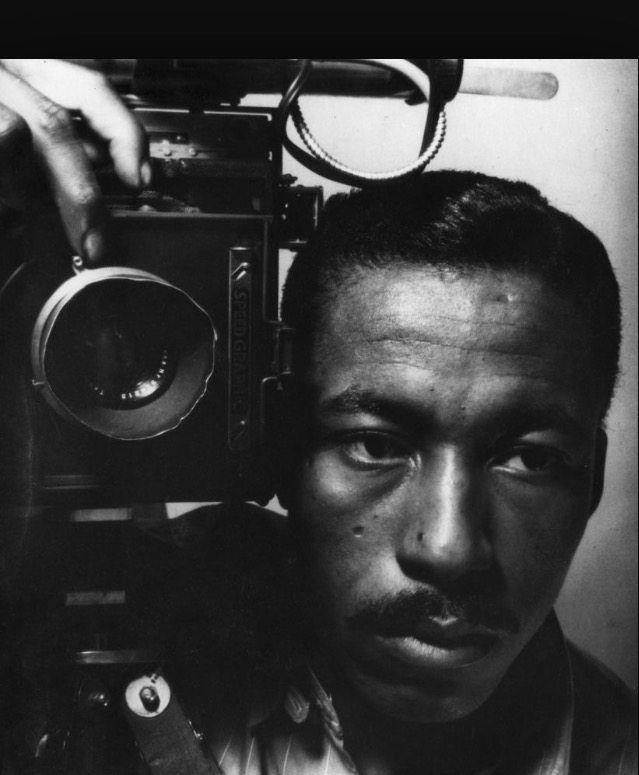 Legendary Photographer Gordon Parks with his camera.