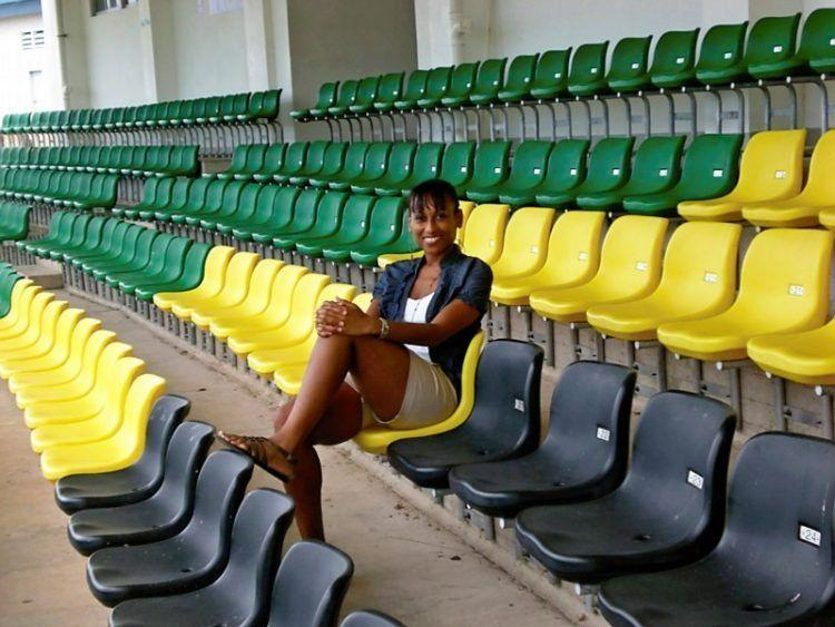 Visit Jamaica: Land I Love. In a stadium in Jamaica decorated with our colors of Black, Green and Gold.