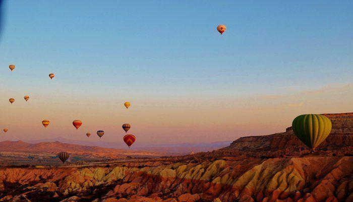 Cappadocia Hot Air Balloon Ride! A thrilling and colorful hot air balloon ride through the beautiful landscape of Cappadocia Turkey! Read about this once in a lifetime experience!