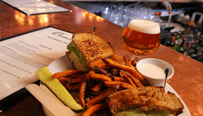 10 Must Visit Bars In Atlanta including Ormsby's, Holeman & Finch, The Vortex & more!