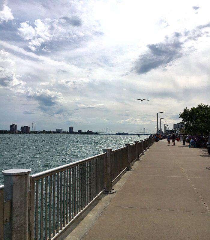 The Detroit Riverwalk with the Ambassador Bridge And Windsor skyline in the background