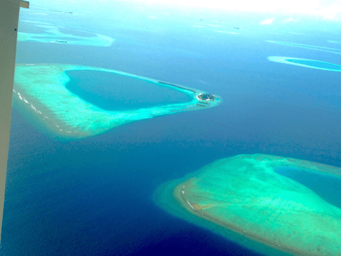 clear blue and green water of The Maldives