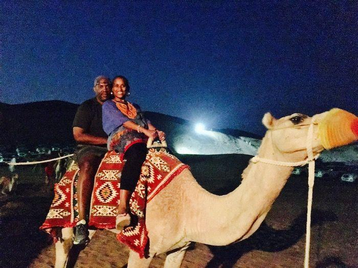 couple on camel at night