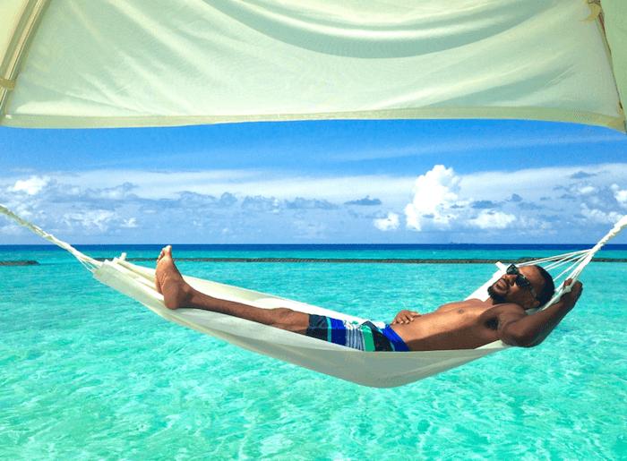 man in hammock over ocean