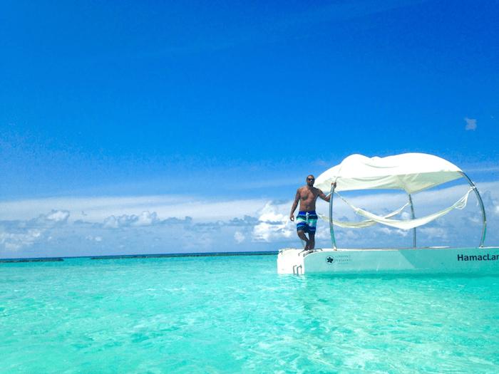 man at edge of platform overlooking ocean