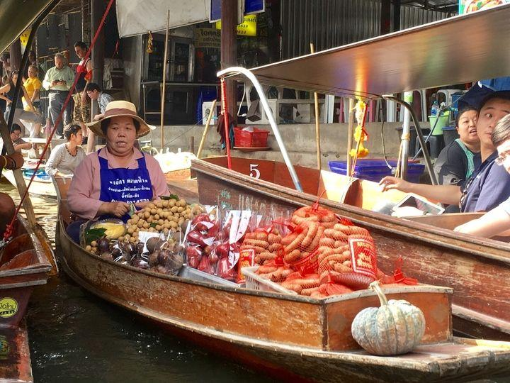 sausage seller in boat