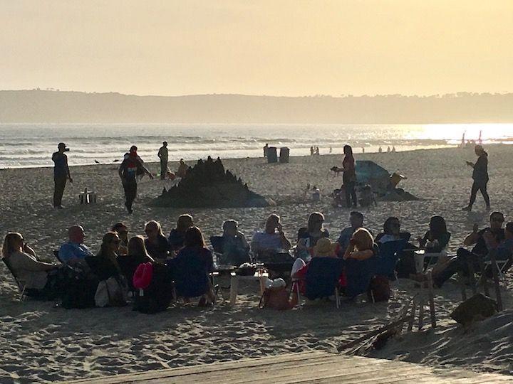 people around bonfires on the beach at Coronado Island