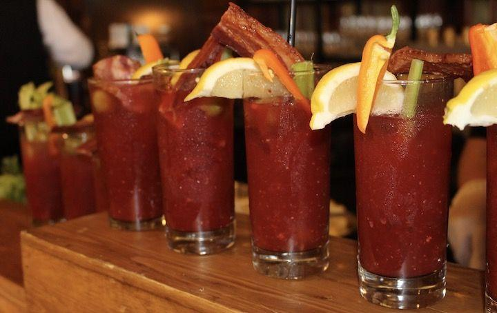 a row of Bloody Mary drinks at The Crown Room