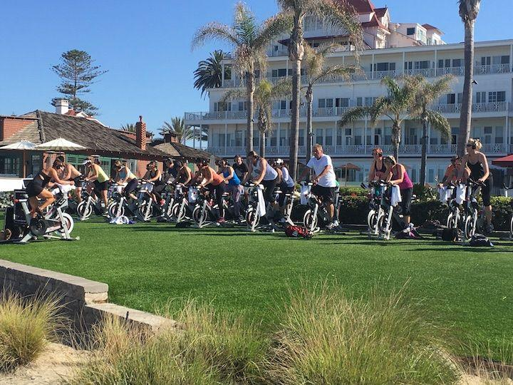 people on spin bikes outside in front of Hotel Del Coronado