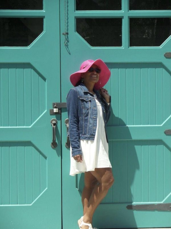 woman in front of teal door