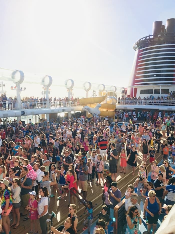 crowd at a sail away party on a Disney cruise ship