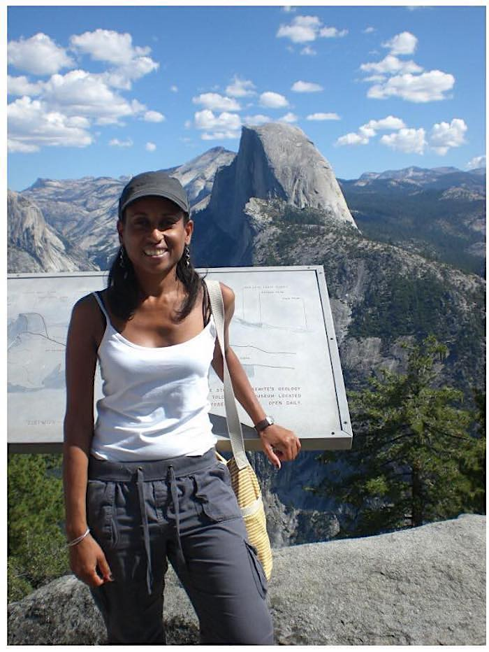 the author standing in front of Half Dome in Yosemite National Park