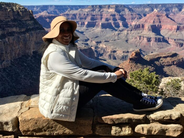 the author sitting overlooking the South Rim of the Grand Canyon