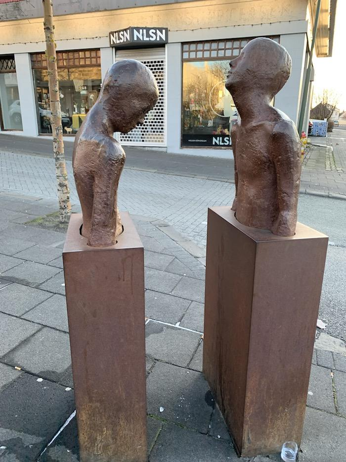 Sculptures of two people in Reykjavik