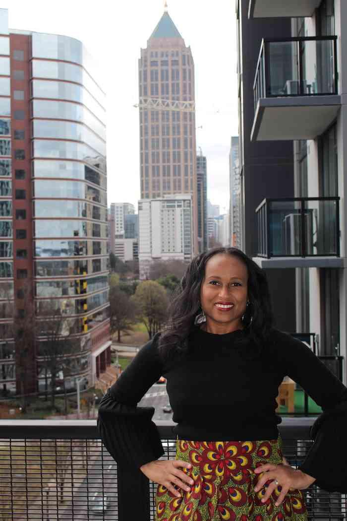 Nadeen on the balcony at Canopy Atlanta Midtown