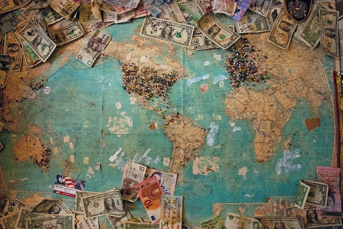 map covered in different currency