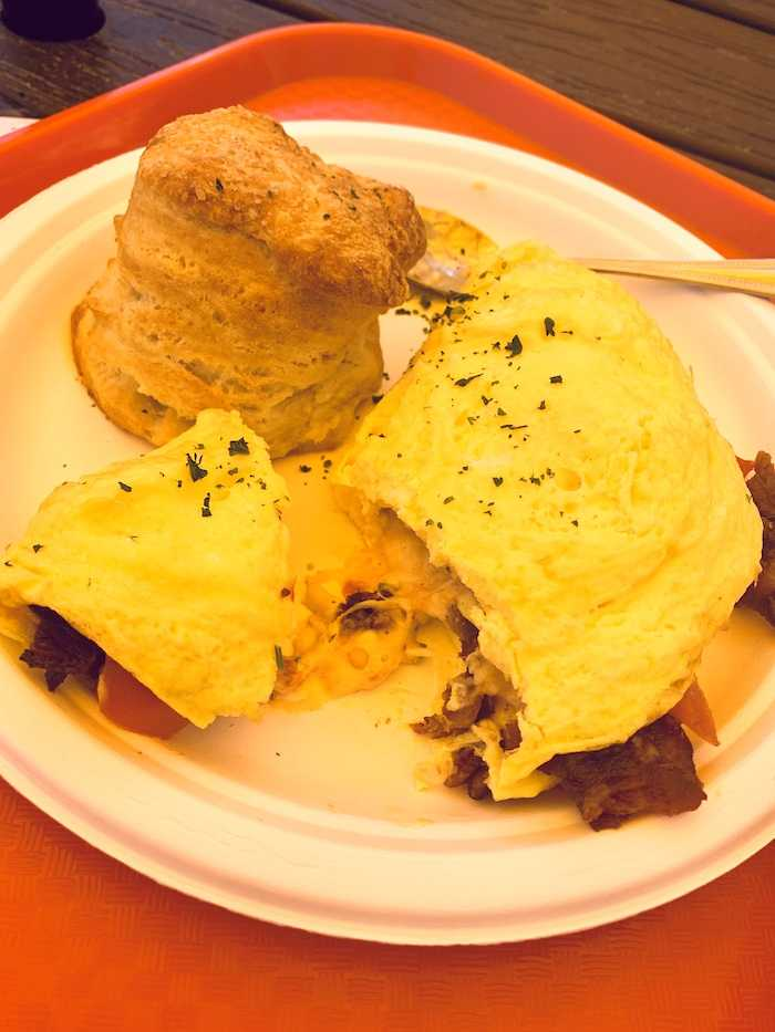 Bacon tomato and pimento cheese omelet and a fluffy biscuit at Sunny Point Cafe